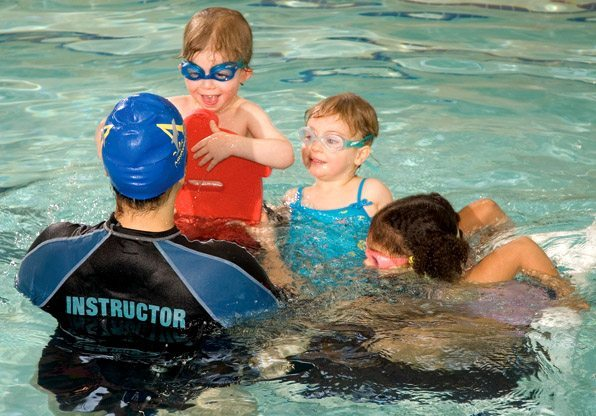 Swimming Instructor with Student Swimming Class