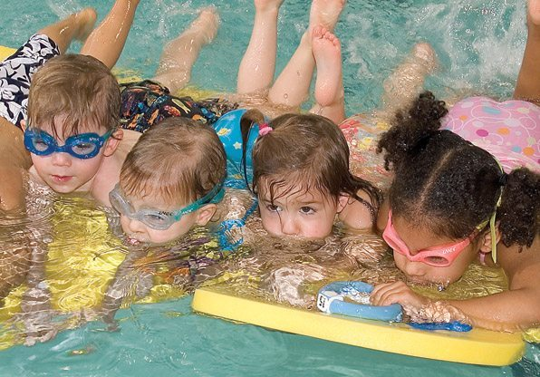 Swimming Class Kids on Floating Duck Mat